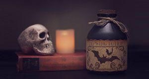 image of spooky skull and poison bottle